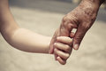 Old hand and baby hand Royalty Free Stock Photo