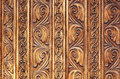 Old hand-carved wooden pattern on a monastery door Royalty Free Stock Photo