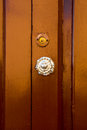Old handle on the wooden door Royalty Free Stock Photo