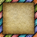 Old handmade paper or canvas sheet on colored background Stock Image