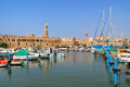 Old harbor acre israel small with yachts and boats and ancient walls of khan al umdan in Stock Image
