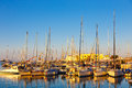 Old harbour of Heraklion with fishing boats and marina during twilight, Crete, Greece