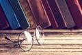 Old hardback books and eyeglasses eye glasses Royalty Free Stock Image