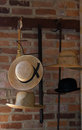 Old hats on a metal display are arranged for sale pole Royalty Free Stock Image