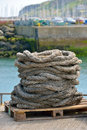 Old hawser rope in harbor Stock Photos