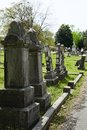 Old headstones stand as sentries in a row Royalty Free Stock Photo