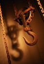 OLD HEAVY INDUSTRIAL CRANE HOOK AND CHAINS Royalty Free Stock Photo