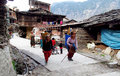 Old himalayan women with traditional baskets on the street two dressed in colorful clothes carrying town Stock Photography