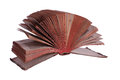 Old historic book with fanned pages on white Stock Image