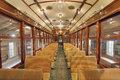 Old historic restored tram public section interior with wood bench seats in general non smoking Stock Photo