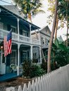 Old historic white building house with American flag on facade in Key West town city in Florida USA Royalty Free Stock Photo