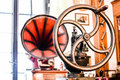 Old homely interior gramophone and chopper in restaurant Royalty Free Stock Photography
