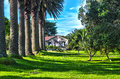 Old homestead this is an in the wagener holiday park far north new zealand palm trees and beautiful lawn create an idilic setting Stock Images