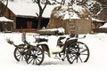 Old horse drawn carriage in the snow Royalty Free Stock Photography