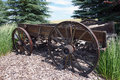 An old horsedrawn wagon fashioned transport used in pioneer days gracing the entrance to a ranch in idaho Royalty Free Stock Photography