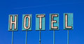 Old Hotel Sign And Airplane Isolated On Blue Royalty Free Stock Photo