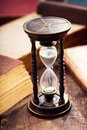 Old hourglass with books Royalty Free Stock Photo