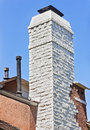 Old house chimney made out of brick on an Stock Image
