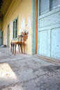 Old house details abandoned with two wooden chairs near the entry door Royalty Free Stock Images