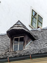 Old house with dormer and shingles architecture revived Stock Images