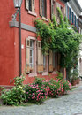 Old house facade with flowers. Stock Images