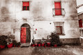 Old house facade. Vintage color. Red isolated. Royalty Free Stock Photo
