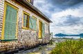 Old house in front of the bay Royalty Free Stock Photo