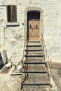 Old house front door and stairs vintage italian scene an with small window clothes drying stand typical scenario location ostuni Stock Images