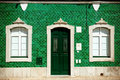 Old house with green tiles on facade Royalty Free Stock Photography