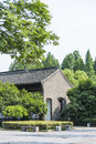 Old house and green tree this photo was taken in egret island park nanjing city jiangsu province china Stock Image