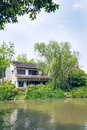 Old house and green tree this photo was taken in egret island park nanjing city jiangsu province china Stock Photography