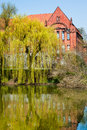 Old house by the lake traditional brick in eastern berlin germany Royalty Free Stock Image