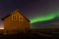 Old house and northern lights an some just outside of reykjavik city Royalty Free Stock Photos