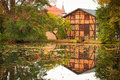 Old house with reflection in the pond poland Stock Images