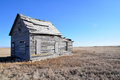 Old house on winter prairie Royalty Free Stock Photo