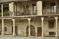 Old houses with balcony on pillars traditional stone at the plaza mayor main square of pedraza village segovia spain Stock Photo