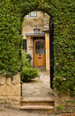 Old houses in cotswold district of england entrance to front door cottage stanton or cotswolds southern the autumn Royalty Free Stock Photos
