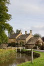Old houses in cotswold district of england lower slaughter with river or cotswolds southern the autumn Royalty Free Stock Photo