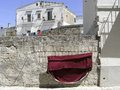 Old houses of Matera, Italy, with clothes hanging Stock Image