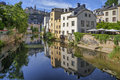 Old houses reflecting alzette river in smooth water of in luxembourg Royalty Free Stock Image