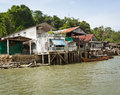 Old houses on river bank thailand the Stock Photo