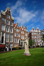 Old houses and sculpture on the lawn, Amsterdam Royalty Free Stock Photography