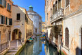 Old houses and small canal in Venice, Italy. Royalty Free Stock Photo