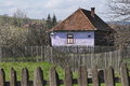 Old hungarian house and fences purple wooden in transylvania romania Stock Images