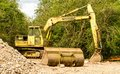 Old hymac digger with caterpillar wheels and bucket Royalty Free Stock Photo