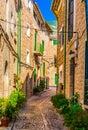 Mediterranean beautiful street alley in old village on Majorca island, Spain Royalty Free Stock Photo