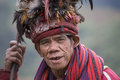 Old ifugao man in national dress next to rice terraces. Banaue, Philippines. Royalty Free Stock Photo