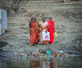 Old indian lady standing in the bank of the ganges river varanas in inida Stock Photography