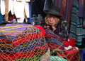 Old indian seller is sleeping chichicastenango guatemala december a very wearing a dark hat in his open air shop in the market on Royalty Free Stock Photo