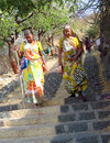Old Indian women in sari going by the stairs Royalty Free Stock Photo